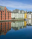 Colorful buildings alesund norway are reflected in the waterway known as alesundet in the coastal city of in southwest on the Stock Images