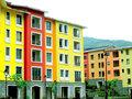 Colorful buildings made of stone painted with yellow orange green and red color Royalty Free Stock Images