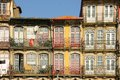 Colorful buildings in the old town porto portugal picturesque and with iron balconies along cais da ribeira street by river douro Royalty Free Stock Photos