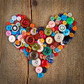 Colorful buttons heart on wooden Stock Images