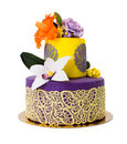 Colorful cake decorated with candy flowers and lace purple yellow edible isolated on white Royalty Free Stock Image