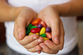 Colorful candies in children s hands Royalty Free Stock Photography