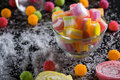 Colorful candies, jelly and marmalade and jellybeans around a ce Royalty Free Stock Photo