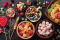 Colorful candies jelly and marmalade on stone background top view Stock Image