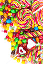 Colorful candies and lollipops on a white background Stock Images