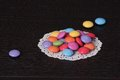 Colorful candies pile on black table Royalty Free Stock Image