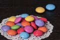 Colorful candies pile on black table Stock Images