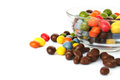 Colorful candies with raisins and peanuts in vase isolated on white background Stock Images