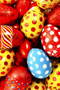 Colorful candy easter eggs wrapped in foil isolated on white background Royalty Free Stock Images