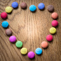 Colorful candy heart on wooden background Royalty Free Stock Photo