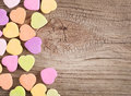 Colorful candy hearts on wooden background Royalty Free Stock Photo