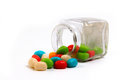Colorful candy in a little bottle isolated on white background Royalty Free Stock Photography
