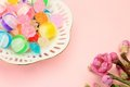 Colorful candy and peach blossom Stock Images