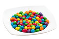Colorful candy white plate of isolated over white background sweet color Stock Photos