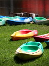 Colorful canoes on a lake bank with nice green grass for rent in city park in bangkok Royalty Free Stock Image