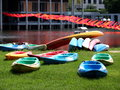 Colorful canoes on a lake bank with nice green grass for rent in city park in bangkok with art installation in the Royalty Free Stock Photo