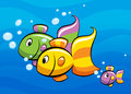 A colorful cartoon tropical fish family swimming Royalty Free Stock Photo