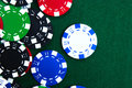 Colorful casino chips on green felt Royalty Free Stock Images