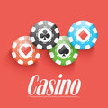 Colorful casino chips on red background shiny Stock Photo