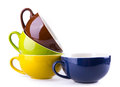 Colorful ceramic cup on white background Royalty Free Stock Photos