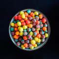 Colorful cereal breakfast in a blue bowl shot from above with pure black background Royalty Free Stock Photography