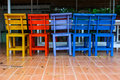 Colorful chairs wood on the floor Royalty Free Stock Image