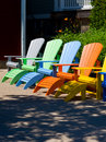 Colorful chairs wooden muskoka adirondack Royalty Free Stock Image