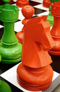 Colorful chess knight is standing on board Royalty Free Stock Images