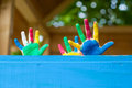 Colorful children's hands in playhouse little children showing their inside the Royalty Free Stock Images