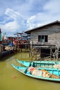 Colorful chinese fishing boat resting at a Chinese Fishing Village- Sekinchan, Malaysia Royalty Free Stock Photo