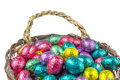 Colorful chocolate easter eggs in a basket wrapped aluminum foil isolated on white background Royalty Free Stock Photography