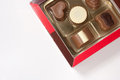 Colorful chocolates box on white background Stock Images