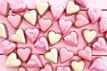 Colorful chocolates in heart shape milk shapes on pink Stock Photography