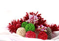 Colorful christmas balls as background with red tinsel on white Stock Photos