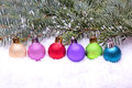 Colorful christmas balls lying on snow Royalty Free Stock Image