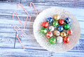 Colorful Christmas balls in white bowl Royalty Free Stock Photo