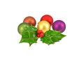 Colorful christmas baubles with small bunch of fresh holly Stock Photo