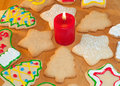 Colorful Christmas cookies surrounding a red candl Royalty Free Stock Images