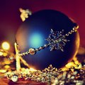 Colorful christmas Decoration. Winter holidays and traditional ornaments on a Christmas tree. Lighting chains - candles for season Royalty Free Stock Photo