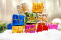 Colorful christmas gifts in snow Stock Image
