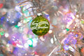 Colorful christmas ornaments background a selective focus still life of a flaking antique green ornament on an abstract silver Royalty Free Stock Photos