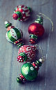 Colorful christmas ornaments on wooden background Stock Images