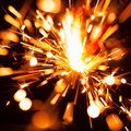 Colorful christmas sparkler with particles Royalty Free Stock Image