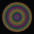 Colorful circular ethnic design funky abstract geometric mandala on black background Royalty Free Stock Photography