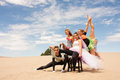 stock image of  Colorful circus performers in the desert horizontal