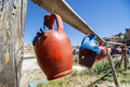 Colorful clay jugs hanging in a line, Cappadocia, Turkey Royalty Free Stock Photo