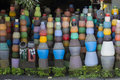 Colorful clay pots on the ground. Tourist art and craft market. Bali Island, Indonesia