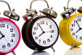 Colorful Clocks on White Stock Image