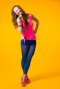 Colorful clothes beautiful girl wearing yellow background Royalty Free Stock Photo