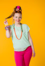 Colorful clothes happy girl with yellow background Royalty Free Stock Photography